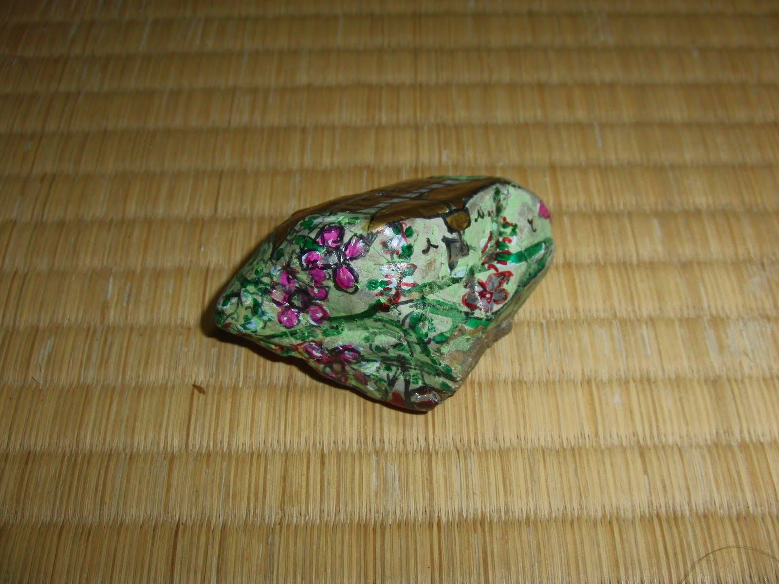 Piedra pintada artista japonés